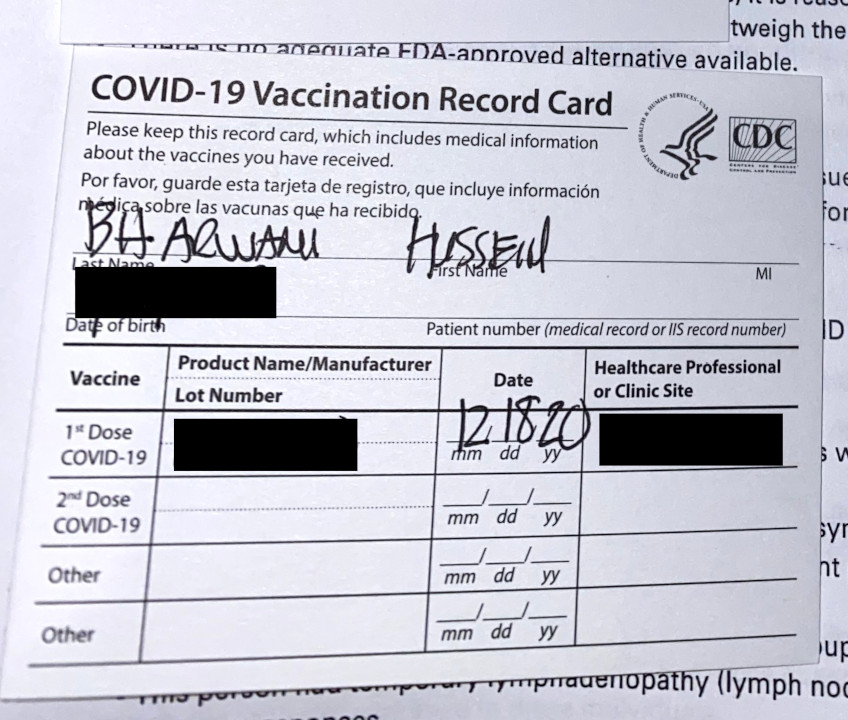A photograph of my COVID-19 vaccination record card.